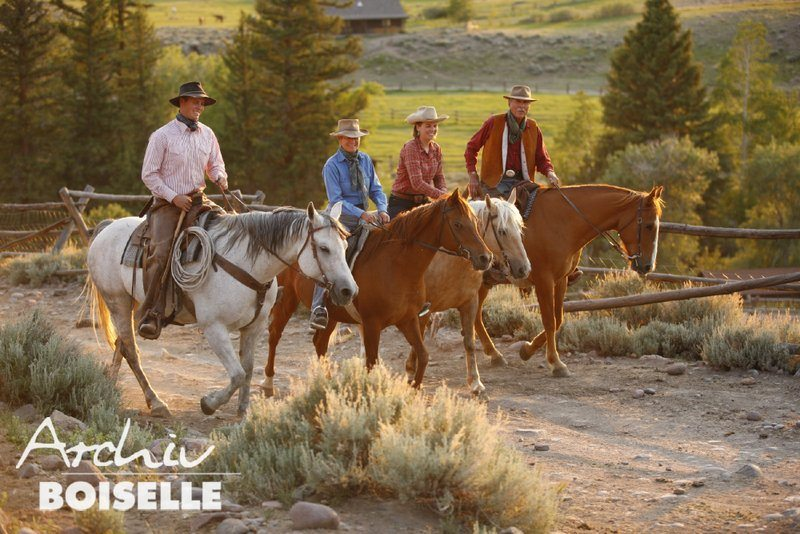 The Fox family riding at their home, the Bitterroot Ranch in Wyoming.